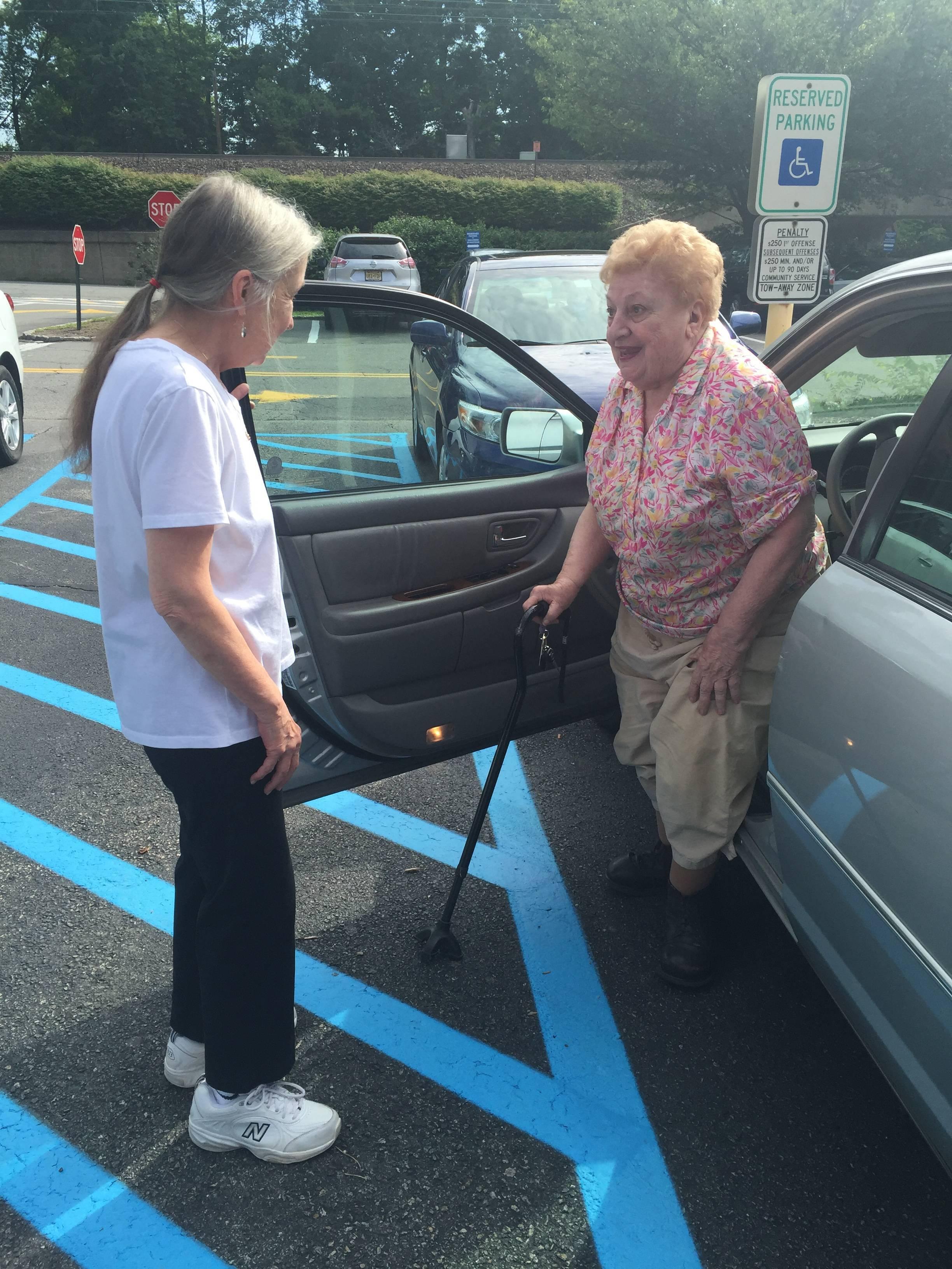 769ba81743c5bddaf3c7_Ann_and_Betty_getting_out_of_car.JPG
