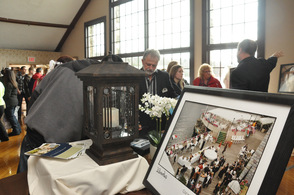 Larry Patton of the Lake Mohawk Country Club shows a bride and groom-to-be photos of the Lake Mohawk Country Club.