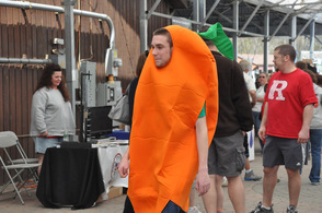 A costumed carrot walks through the crowd.