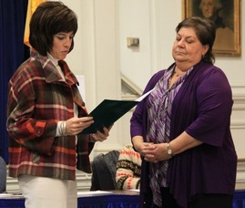 Kelly McEvoy takes her oath with Linda Alvarez