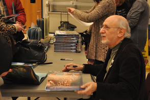 Peter Yarrow signing books for fans.