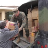 Small_thumb_8b00e2a8723e60533960_beverly_gordon_receives_toys_from_gunnery_sergeant_kevin_battavio
