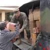 Small_thumb_8b00e2a8723e60533960_beverly_gordon_receives_toys_from_gunnery_sergeant_kevin_battavio