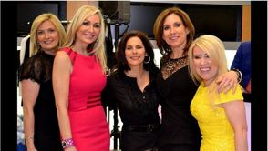 "(L to R)  Long Valley Leader Kathy Reidinger, ""Housewife"" Kim DePaola, Montville Leader and LHS graduade Aimee Schenkel, Summit/New Providence Leader Melanie Wilson and Attorney Karolina Dehnhard model fashions from Posche boutique at the B.I.G. (Believe, Inspire, Grow)  ""Celebrate the Best Version of You—an Evening of Fun, Fashion, and Celebration"" held April 3 at Budd Larner Associates in Short Hills."
