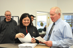 Helen Wilson LeFrois, submits her petition to Sussex County Clerk, Jeff Parrott, as husband Greg LeFrois, and Ernie Skellenger are pictured in the background.