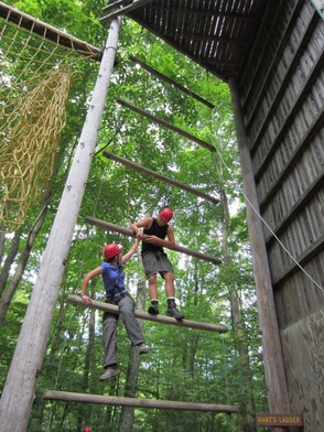 Crew President Katie Rozek and Crew Vice President Chris Rozek helping each other on the Giants ladder