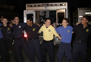 The Rescue Squad sings along with the Movin' Out Band