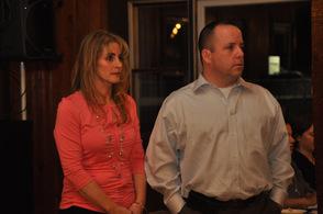 Kim and Mike Strada listen as Glen Vetrano speaks.