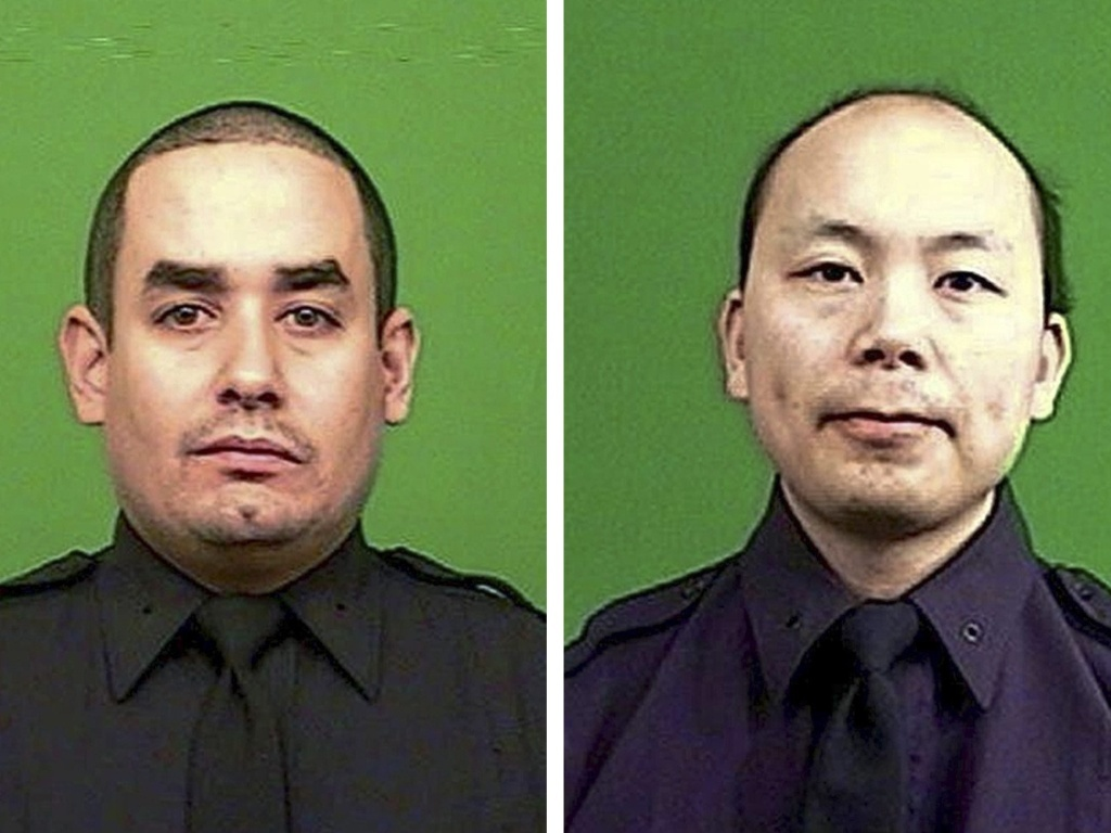 dd4058507099e9e13ca6_NYPD_officers_photo_12-21-14.jpg