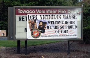 Welcome home banner for Nick's homecoming, donated by Class Act in Lake Hiawatha