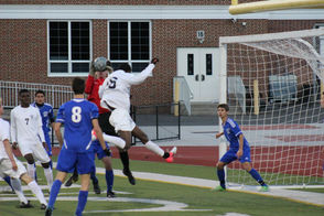 Millburn keeper Marc Langendorff jumps up and snatches a cross into the box by the Mounties.
