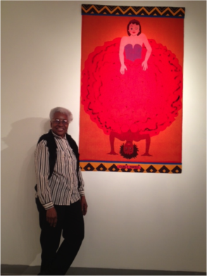 "Nettie Thomas, Curator of the 1978 Maplewood Arts Center, standing alongside Emma Amos' famous painting ""Curly Topsy""."
