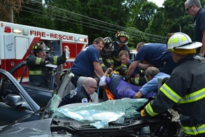 Members of the Sparta Township Fire Department and Sparta First Aid Squad extricate 23-year-old Anthony L. Barbato from his heavily damaged vehicle and move him to a waiting ambulance.  Barbato was seriously injured as result of this accident on Thursday afternoon on Rte. 517 in Sparta