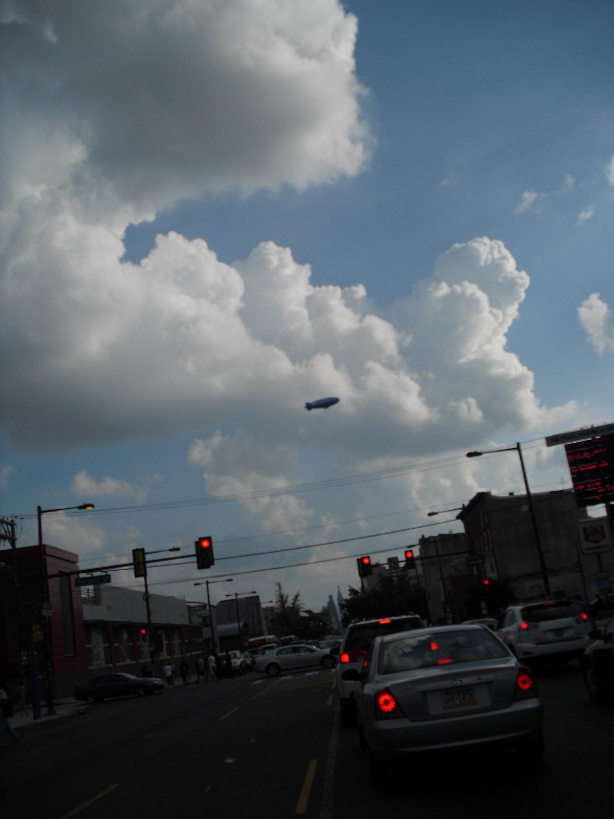 40b6f149f19e012619b5_Phil-2-blimp___clouds.jpg