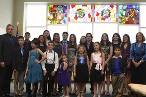 Fashion models in Congregation Beth Israel's social hall.