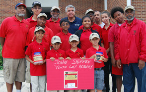 Scotch Plains Mayor Kevin Glover and members of the JSYGA youth golf club