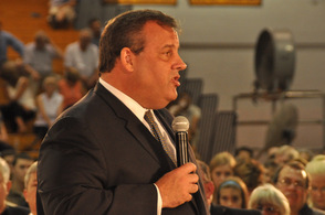 Governor Chris Christie answers questions for audience members at the right side of the auditiorium.