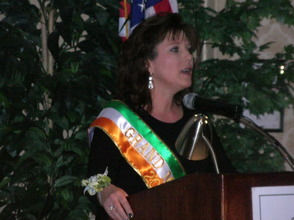 Dawn Delaney, one of the 2013 Parade Grand Marshals, at the podium.