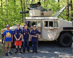 Local Cub Scouts from Pack 98 in front of a Humvee