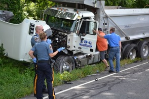 Investigating Officer Arlene Lippencott discusses the crash with the department's Certified Crash Reconstructionist Cpl. Brian Hassloch.  The driver of the pictured Tandem Dump Truck was uninjured after a drunk driver entered into his lane of travel and crashed into him early Thursday afternoon