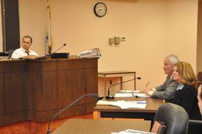 Jessica Caldwell and Stuart Koperweis present their plan to the town council, as Town of Newton Town Manager Thomas S. Russo, Jr., listens intently.