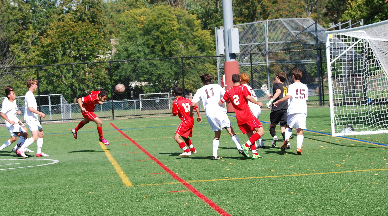 8951905c4727fd8f54fa_2013_boys_soccer_varsity_marzo_header_goal_2-2.jpg