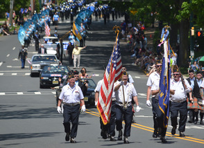 The American Legion color guard leads the parade down Martine Ave. in Fanwood