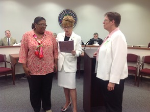 "Gail Phoebus presents the proclamation to Shauna Gregory (left) and Barbara Miller (right) for ""National Children's Mental health Awareness Day."""
