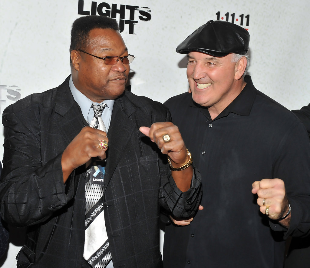 8fc7a538d2960fba4c98_Cooney_and_Larry_Holmes.jpg