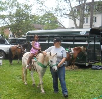11dcbc04bfa90436345e_girl_on_horse.jpg