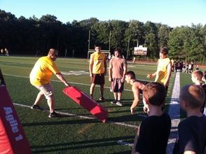Coach Katz running through drills with Junior Warrior and Pop Warner players