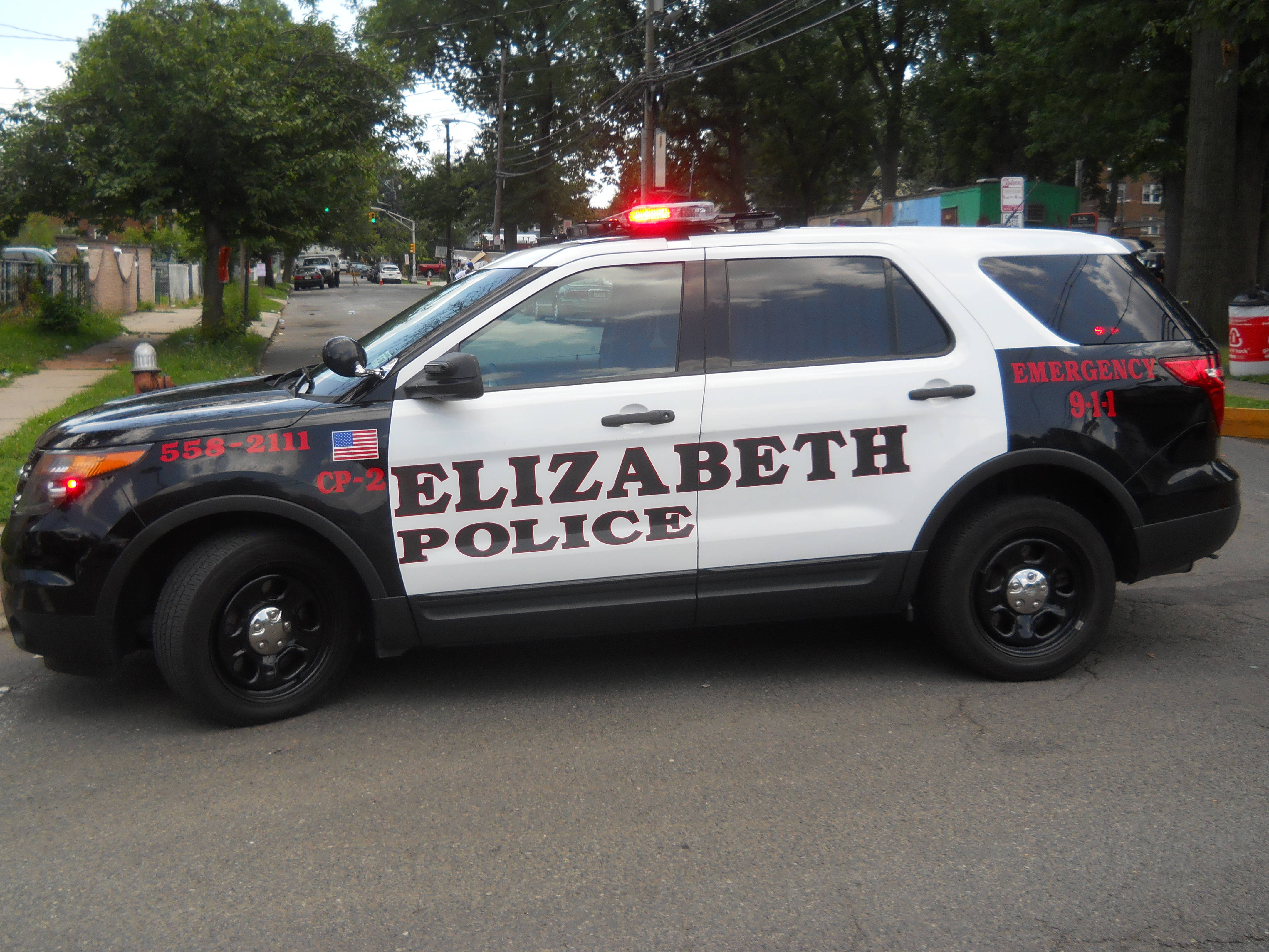 405d95a1d899fd54120f_Police_Car.jpg