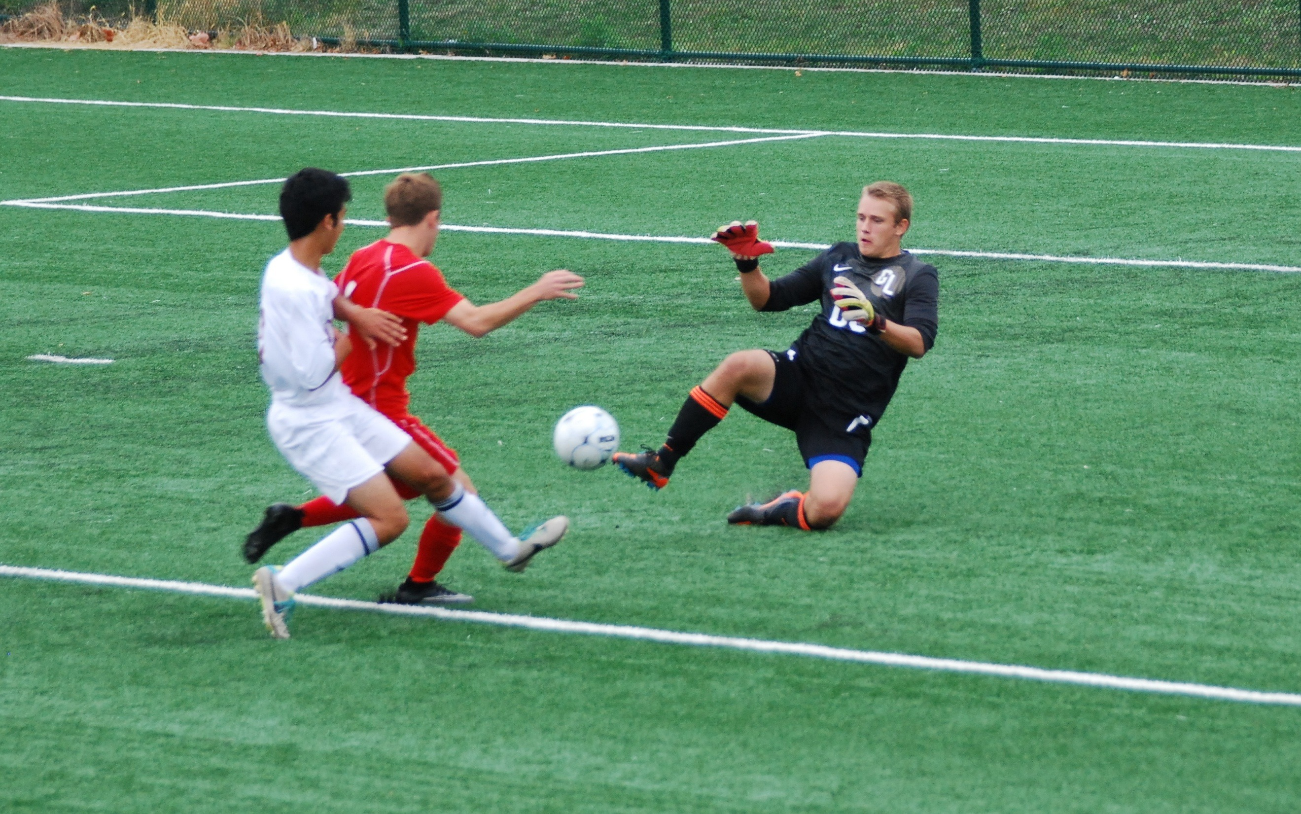 489b3ac2780e9ab2a303_2014_boys_varsity_jake_making_sliding_save_vs_union__1_.jpg