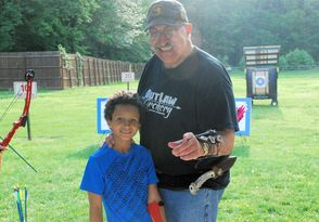 Gerry Decaro with an archery student