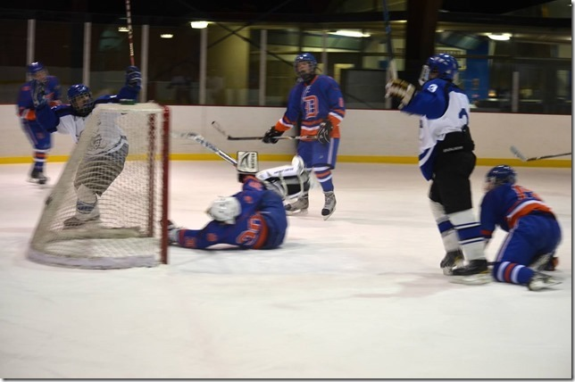 5187fd8f248c63596bff_Davey_Leong__11__behind_the_net__celebrates_his_first_goal_of_the_night.jpg