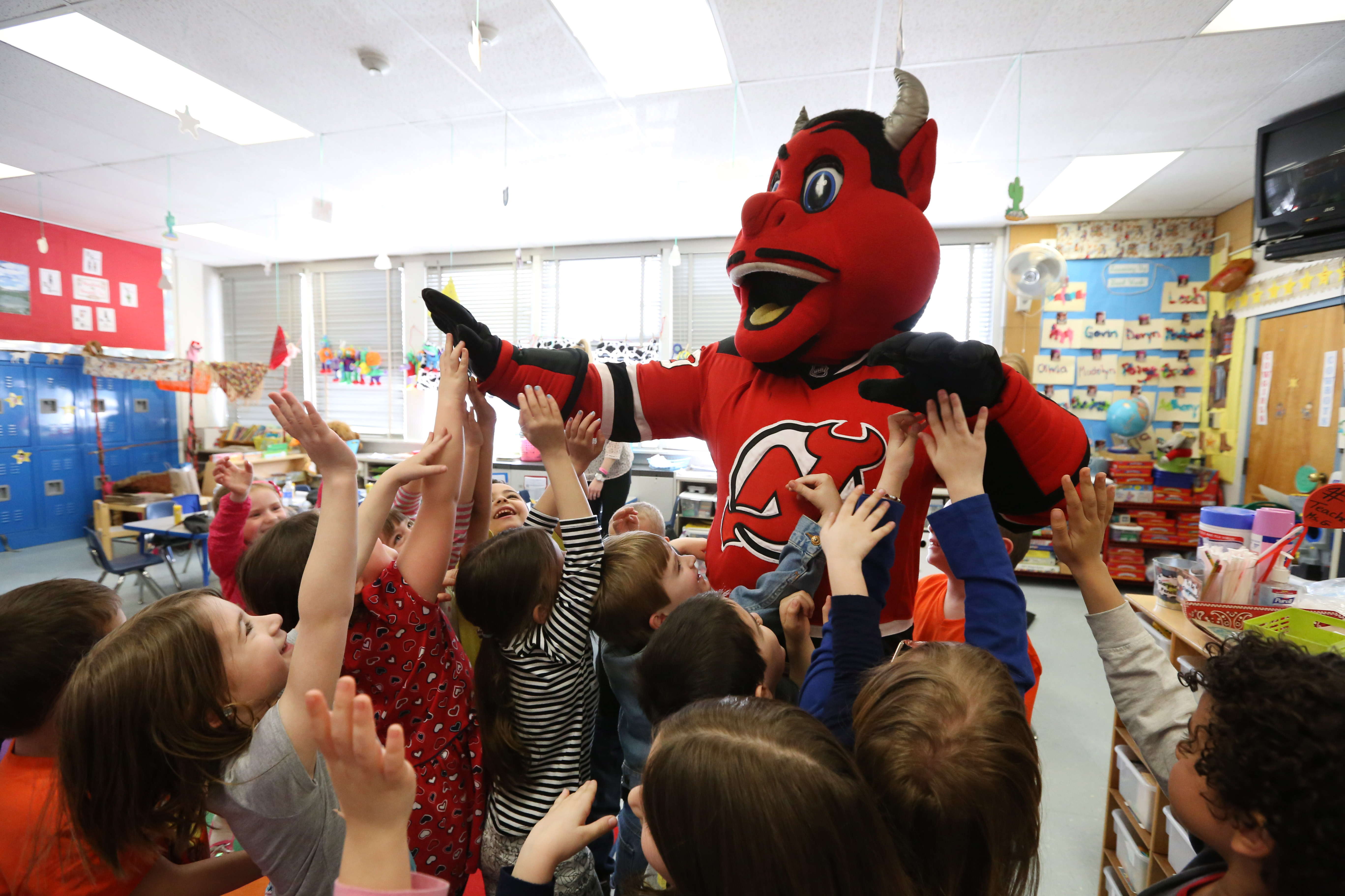 Worksheet Reading Programs For Elementary new jersey devils launch reading program for elementary school the nj mascott gives students high fives during his visit to their credits sean conklin