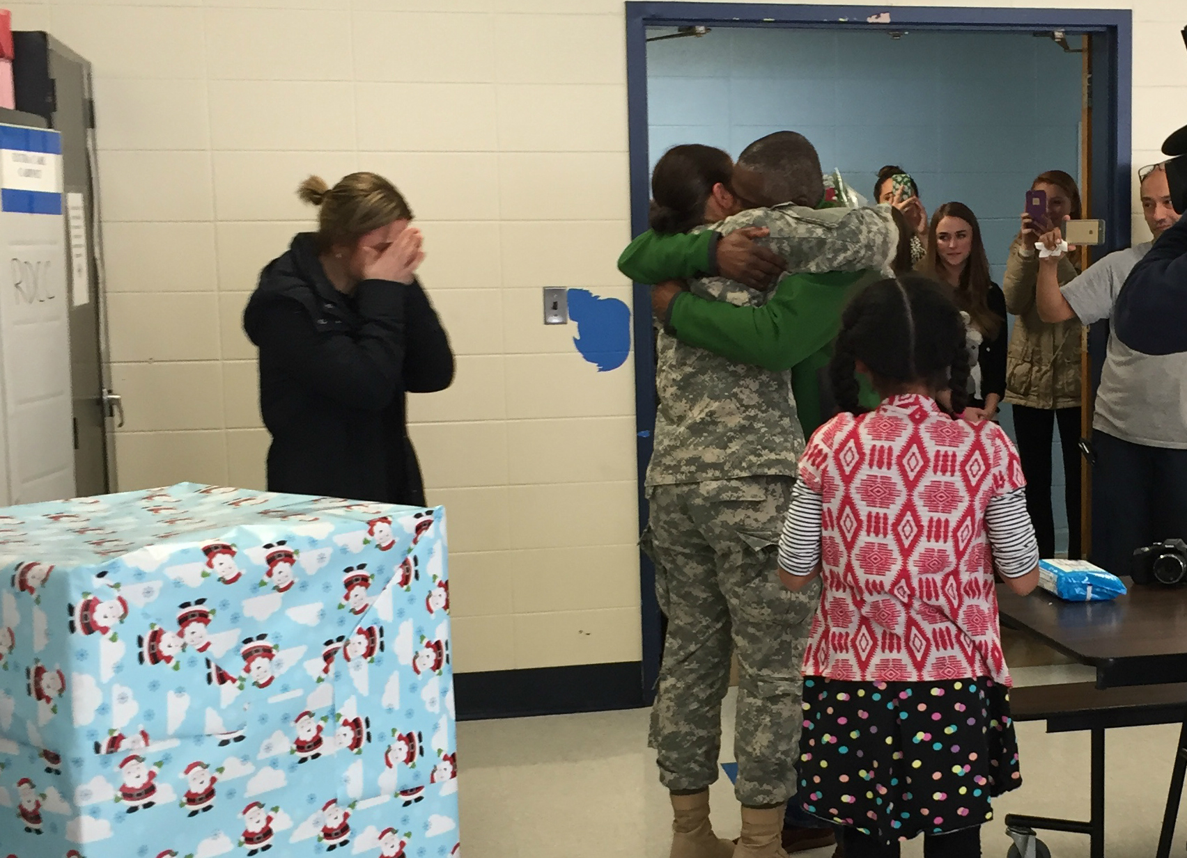 88dd20237d58c429f314_Jefferson_Military_Surprise_-_Salome_and_Dad_Embrace.jpg