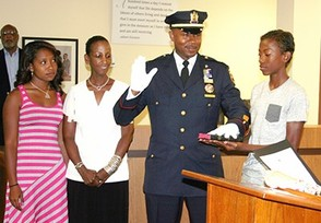 Wilhelm Young with his family as he is sworn in as a Lieutenant of the MPD