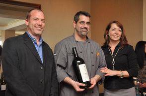 Executive chef Chris Masey of Nicole's Ten is presented with a Napa Cellars Wine by Joe Shirley, and Deborah Smith of JerseyBites.com.