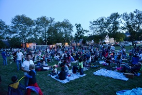 Community participants at family movie night under the stars.