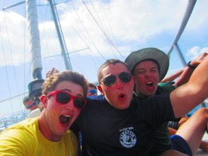 Scouts Ryan Stahlin, Andrew Friedlander and Senior Patrol Leader Peter Krasny take a break from sailing in the Bahamas