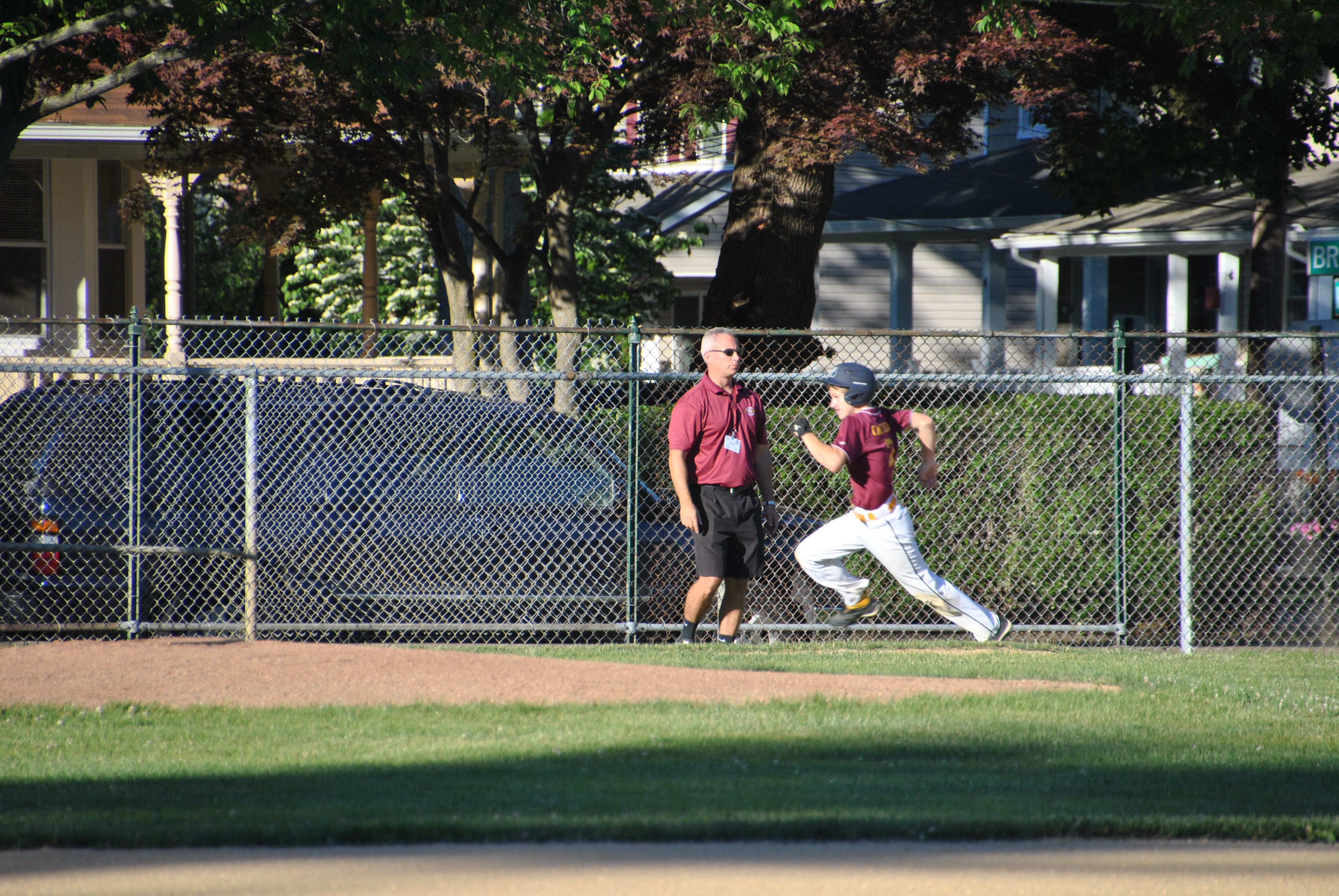 0a5dd7d49db44dc5a456_Ryan_Canfield_storming_home_past_his_3rd_base_coach_and_Dad__Paul_Canfield.JPG