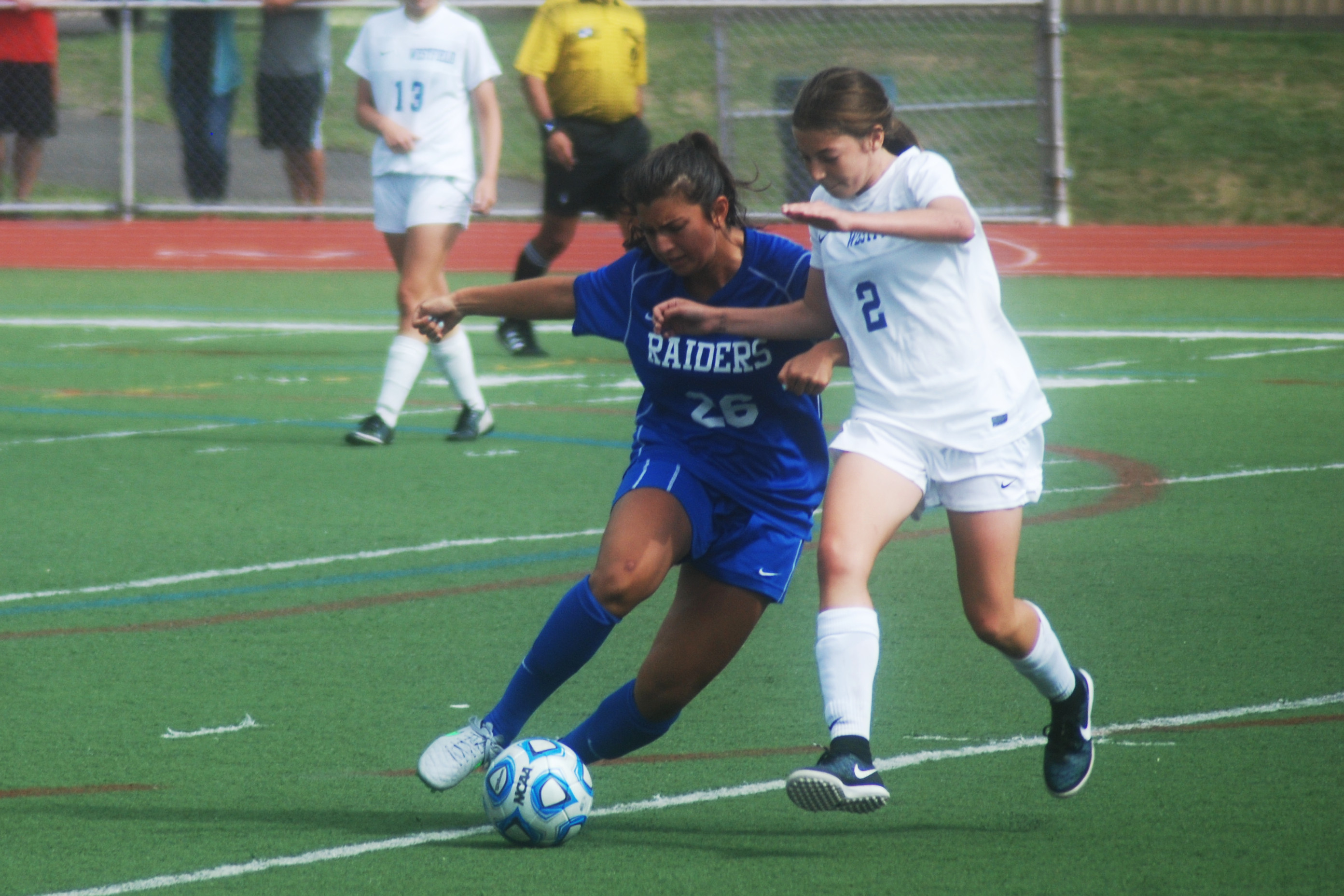 df3936b41218d34f8fdb_18a16d2a8f96de8d493d_Sophie_Brause_of_Scotch_Plains-Fanwood_and_Carly_Bechtloff_of_Westfield_fight_for_the_ball.__katherine_gillen.JPG