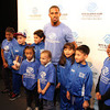 Small_thumb_fcba4ad876ea8db2b5c9_victor_cruz_with_kids_2
