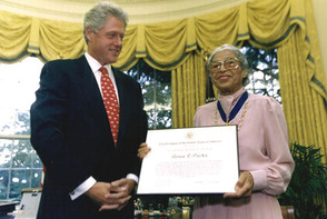 Rosa Parks receiving the award from Bill Clinton.