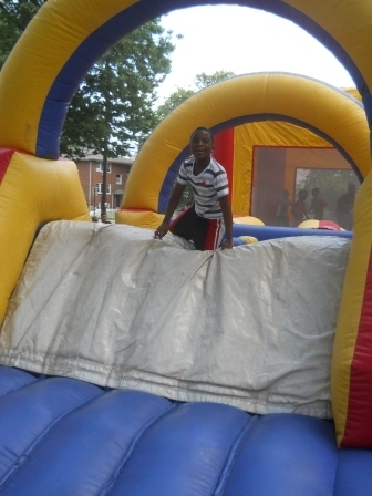 0abf746643f4c7ee063a_Boy_on_inflatable.jpg