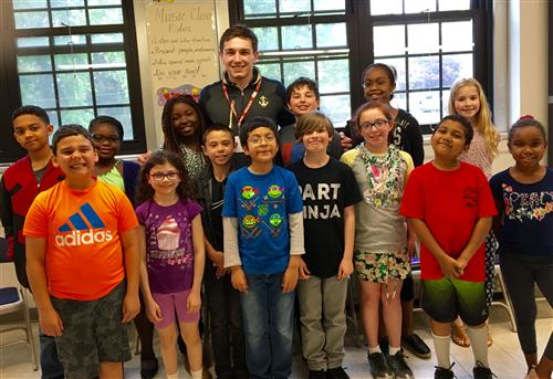 aacae04a9f5769a0395c_Dylan_Pennell_with_students_in_Mrs._Stoner_s_St._Cloud_Fourth_Grade_class..jpg