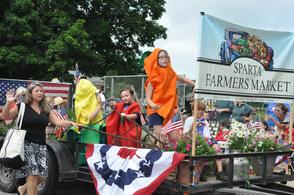 Veggies dance for the Sparta Farmers Market.