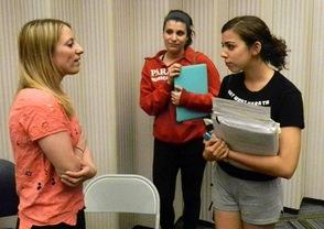 Chelsea Matiash talks with photo students.
