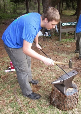 Crew Vice President of Program Chris Rozek forging a arrowhead